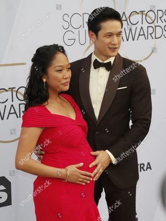 Stock Photo of Shelby Rabara (L) and Harry Shum Jr. arrives for the 25th annual Screen Actors Guild Awards ceremony at the Shrine Auditorium in Los Angeles, California, USA, 27 January 2019.