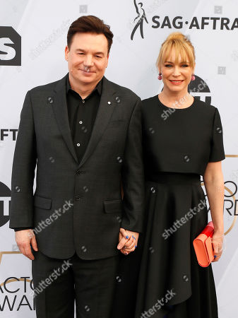 Mike Myers (L) and Kelly Tisdale (R) arrive for the 25th annual Screen Actors Guild Awards ceremony at the Shrine Auditorium in Los Angeles, California, USA, 27 January 2019.