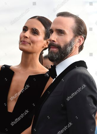 Maria Dolores Dieguez, Joseph Fiennes. Maria Dolores Dieguez, left, and Joseph Fiennes arrive at the 25th annual Screen Actors Guild Awards at the Shrine Auditorium & Expo Hall, in Los Angeles
