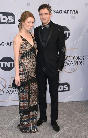 Ashley Hinshaw, Topher Grace. Ashley Hinshaw, left, and Topher Grace arrive at the 25th annual Screen Actors Guild Awards at the Shrine Auditorium & Expo Hall, in Los Angeles