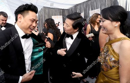 Jon M. Chu, Ken Jeong, Tran Jeong. Jon M. Chu, from left, Ken Jeong, and Tran Jeong arrive at the 25th annual Screen Actors Guild Awards at the Shrine Auditorium & Expo Hall, in Los Angeles