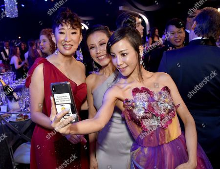 Sandra Oh, Tan Kheng Hua, Fiona Xie. Sandra Oh, from left, Tan Kheng Hua, and Fiona Xie attend the 25th annual Screen Actors Guild Awards at the Shrine Auditorium & Expo Hall, in Los Angeles