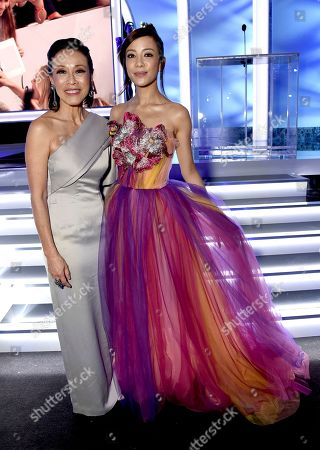 Tan Kheng Hua, Fiona Xie. Tan Kheng Hua, left and Fiona Xie attend the 25th annual Screen Actors Guild Awards at the Shrine Auditorium & Expo Hall, in Los Angeles
