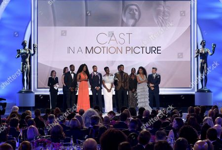 """Stock Picture of Sydelle Noel, Michael B. Jordan, Danai Gurira, Isaach de Bankole, Chadwick Boseman, Lupita Nyong'o, Angela Bassett. The cast of """"Black Panther,"""" accept the award for outstanding performance by a cast in a motion picture at the 25th annual Screen Actors Guild Awards at the Shrine Auditorium & Expo Hall, in Los Angeles"""