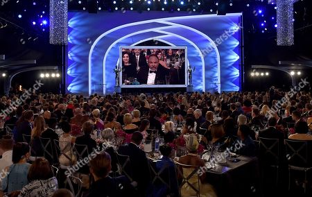 Geoffrey Owens appears on screen at the 25th annual Screen Actors Guild Awards at the Shrine Auditorium & Expo Hall, in Los Angeles
