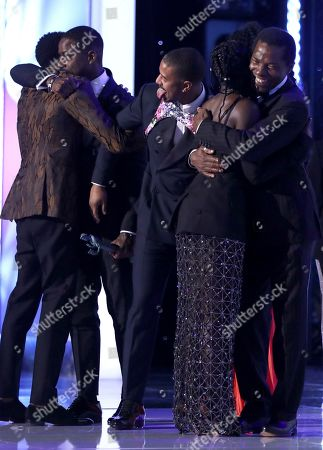 """Stock Image of Chadwick Boseman, Sterling K. Brown, Michael B. Jordan, Lupita Nyong'o, Isaach de Bankole. Cast members from """"Black Panther,"""" from left, Chadwick Boseman, Sterling K. Brown, Michael B. Jordan, Lupita Nyong'o, and Isaach de Bankole, embrace after winning the award for outstanding performance by a cast in a motion picture at the 25th annual Screen Actors Guild Awards at the Shrine Auditorium & Expo Hall, in Los Angeles"""