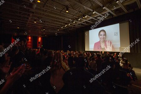 "Alexandria Ocasio-Cortez, Rachel Lears, Paula Jean Swearengin, Amy Vilela, Cori Bush. Rep. Alexandria Ocasio-Cortez, D-N.Y. waves as she appears on screen via video conference for a Q&A session after the premiere screening of the documentary ""Knock Down the House"" during the 2019 Sundance Film Festival, in Park City, Utah"