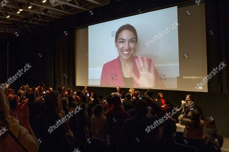 "Alexandria Ocasio-Cortez, Rachel Lears, Paula Jean Swearengin, Amy Vilela, Cori Bush. Rep. Alexandria Ocasio-Cortez, D-N.Y. waves as she appears over video conference in front the audience giving a standing ovation in the MARC theater for a Q&A session along with other subjects and director Rachel Lears after the premiere screening of the film ""Knock Down The House"", a documentary about her as well as Paula Jean Swearengin, Amy Vilela, Cori Bush, during the 2019 Sundance Film Festival, in Park City, Utah"