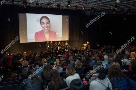 "Alexandria Ocasio-Cortez, Rachel Lears, Paula Jean Swearengin, Amy Vilela, Cori Bush. Rep. Alexandria Ocasio-Cortez, D-N.Y. smiles over video conference during a Q&A session after the premiere screening of the film ""Knock Down The House"", a documentary about her as well as Paula Jean Swearengin, Amy Vilela, and Cori Bush, seen at the front with filmmaker Rachel Lears in the MARC theater during the 2019 Sundance Film Festival, in Park City, Utah"