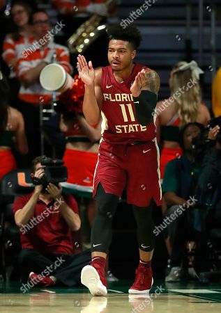 Florida State guard David Nichols celebrates after a play during the first half of an NCAA college basketball game against Miami, in Coral Gables, Fla