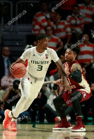 Miami guard Anthony Lawrence II (3) drives past Florida State guard David Nichols (11) during the second half of an NCAA college basketball game, in Coral Gables, Fla. Florida State defeated Miami 78-66