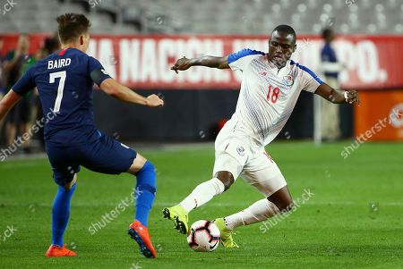 Panama forward Abdiel Arroyo (18) loses control of the ball in front of United States defender Corey Baird (7) during the second half of a men's international friendly soccer match, in Phoenix. The United States defeated Panama 3-0