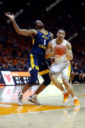 Tennessee forward Grant Williams (2) drives as he's defended by West Virginia forward Derek Culver (1) in the second half of an NCAA college basketball game, in Knoxville, Tenn. Tennessee won 83-66