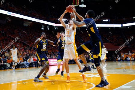 Tennessee forward John Fulkerson (10) goes for a shot as he's defended by West Virginia forward Esa Ahmad (23), forward Lamont West (15) and forward Logan Routt (31) in the first half of an NCAA college basketball game, in Knoxville, Tenn