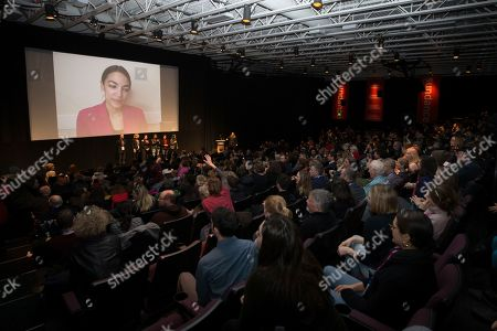 "Stock Image of Rep. Alexandria Ocasio-Cortez, D-N.Y. speaks to the audience in the MARC theater over video conference after the premiere screening of the film ""Knock Down The House"", a documentary about her as well as Paula Jean Swearengin, Amy Vilela, Cori Bush, during the 2019 Sundance Film Festival, in Park City, Utah"