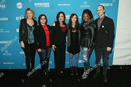 "From left to right, Sarah Olson, Paula Jean Swearengin, Amy Vilela, Rachel Lears, Cori Bush, and Robin Blotnick pose at the premiere of ""Knock Down The House"", a documentary about them as well as Rep. Alexandria Ocasio-Cortez, D-N.Y., not pictured, during the 2019 Sundance Film Festival, in Park City, Utah"