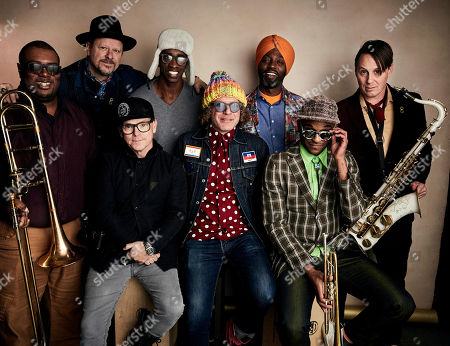 """Danny Clinch, T.G. Herrington, Ronell Johnson, Kyle Roussel, Ben Jaffe, Walter Harris, Branden Lewis, Clint Maedgen. Directors Danny Clinch, second from left, and T.G. Herrington, third from left, pose with Ronell Johnson, Kyle Roussel, Ben Jaffe, Walter Harris, Branden Lewis, and Clint Maedgen of Preservation Hall Jazz Band to promote the film """"A Tuba to Cuba"""" at the Salesforce Music Lodge during the Sundance Film Festival, in Park City, Utah"""