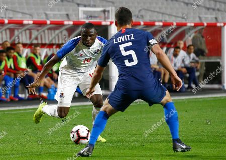 Stock Picture of Panama forward Abdiel Arroyo, left, dribbles the ball as United States defender Daniel Lovitz (5) applies pressure during the first half of a men's international friendly soccer match, in Phoenix. The United States defeated Panama 3-0