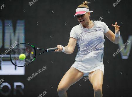 Stock Image of Vera Zvonareva of Russia returns the ball to Ekaterina Makarova of Russia during the St. Petersburg Ladies Trophy-2019 tennis tournament match in St.Petersburg, Russia