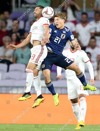 Omid Ebrahimi Zarandini (L) of Iran in action against Doan Ritsu of Japan during the 2019 AFC Asian Cup semifinal round match between Iran and Japan in Al Ain, United Arab Emirates, 28 January 2019.