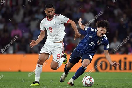 Minamino Takumi (R) of Japan in action against Omid Ebrahimi Zarandini (L) of Iran during the 2019 AFC Asian Cup semifinal match between Iran and Japan in Al Ain, United Arab Emirates, 28 January 2019.