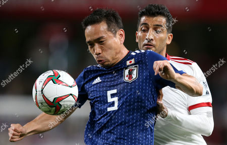 Nagatomo Tuto (L) of Japan in action against Vahid Amiri of Iran during the 2019 AFC Asian Cup semifinal round match between Iran and Japan in Al Ain, United Arab Emirates, 28 January 2019.