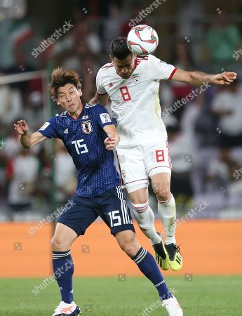 Osako Yuya (L) of Japan in action against Morteza Pouraliganji of Iran during  the 2019 AFC Asian Cup semifinal round match between Iran and Japan in Al Ain, United Arab Emirates, 28 January 2019.