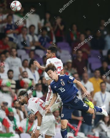 Osako Yuya (R) of Japan in action against Morteza Pouraliganji of Iran during the 2019 AFC Asian Cup semifinal round match between Iran and Japan in Al Ain, United Arab Emirates, 28 January 2019.