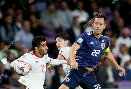 Yoshida Maya (R) of Japan in action against Vahid Amiri of Iran during the 2019 AFC Asian Cup semifinal round match between Iran and Japan in Al Ain, United Arab Emirates, 28 January 2019.