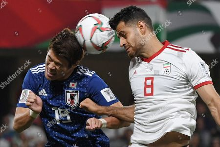 Sakai Hiroki (L) of Japan in action against Morteza Pouraliganji (R) of Iran during the 2019 AFC Asian Cup semifinal match between Iran and Japan in Al Ain, United Arab Emirates, 28 January 2019.