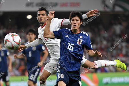 Tomiyasu Takehiro (R) of Japan in action against Vahid Amiri (L) of Iran during the 2019 AFC Asian Cup semifinal match between Iran and Japan in Al Ain, United Arab Emirates, 28 January 2019.