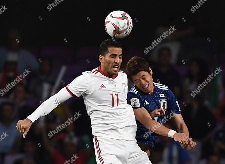Japan's defender Hiroki Sakai, right, jumps for the ball with Iran's midfielder Vahid Amiri, left, during the AFC Asian Cup semifinal soccer match between Iran and Japan at Hazza Bin Zayed Stadium in Al Ain, United Arab Emirates