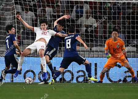 Iran's forward Sardar Azmoun, center left, fights for the ball against Japan's defender Wataru Endo, center right, during the AFC Asian Cup semifinal soccer match between Iran and Japan at Hazza Bin Zayed Stadium in Al Ain, United Arab Emirates