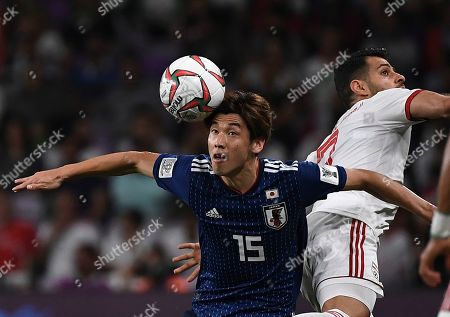 Japan's forward Yuya Osako, left, heads the ball against Iran's defender Morteza Pouraliganji, alright, during the AFC Asian Cup semifinal soccer match between Iran and Japan at Hazza Bin Zayed Stadium in Al Ain, United Arab Emirates
