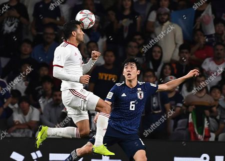Iran's midfielder Vahid Amiri, left, heads the ball against Japan's defender Wataru Endo, right, during the AFC Asian Cup semifinal soccer match between Iran and Japan at Hazza Bin Zayed Stadium in Al Ain, United Arab Emirates, . Japan beat Iran 2-0