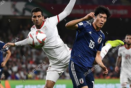 Iran's midfielder Vahid Amiri, left, fights for the ball with Japan's defender Takehiro Tomiyasu, right, during the AFC Asian Cup semifinal soccer match between Iran and Japan at Hazza Bin Zayed Stadium in Al Ain, United Arab Emirates