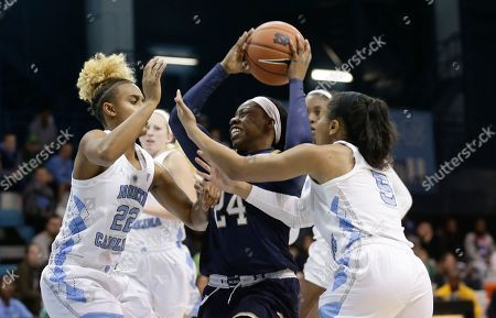 Notre Dame's Arike Ogunbowale (24) is pressured by North Carolina's Paris Kea (22) and Stephanie Watts (5) during the first half of an NCAA college basketball game in Chapel Hill, N.C