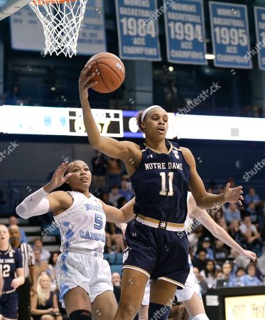 Notre Dame's Brianna Turner (11) grabs a rebound over North Carolina's Stephanie Watts (5) during the first half of an NCAA college basketball game in Chapel Hill, N.C