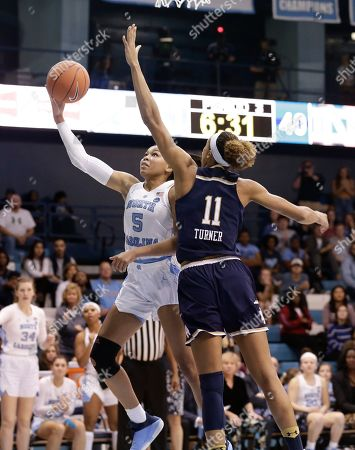 Notre Dame's Brianna Turner (11) guards North Carolina's Stephanie Watts (5) during the second half of an NCAA college basketball game in Chapel Hill, N.C., . North Carolina won 78-73