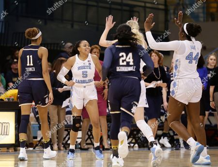 North Carolina's Stephanie Watts (5) reacts with teammates during the second half of an NCAA college basketball game against Notre Dame in Chapel Hill, N.C., . North Carolina won 78-73