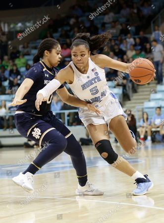 Notre Dame's Jordan Nixon guards North Carolina's Stephanie Watts (5) during the second half of an NCAA college basketball game in Chapel Hill, N.C., . North Carolina won 78-73