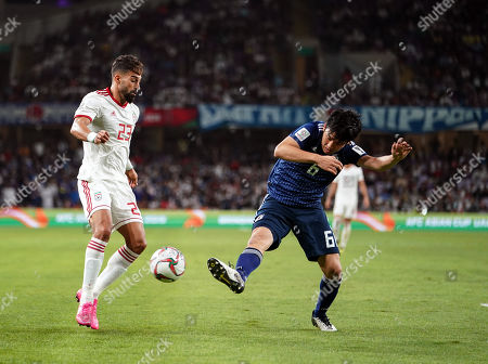Wataru Endo of Japan tackling Ramin Rezaeian of Iran during Iran v Japan at the Hazza bin Zayed Stadium in Abu Dhabi, United Arab Emirates, AFC Asian Cup, Asian Football championship