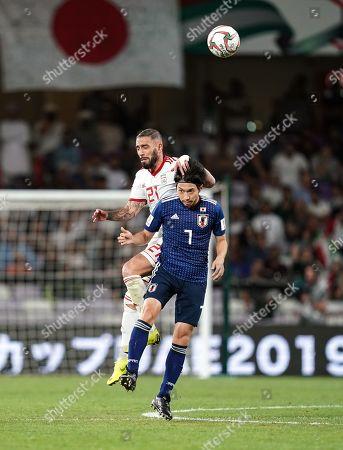 Ashkan Dejagah of Iran fouling Gaku Shibasaki of Japan during Iran v Japan at the Hazza bin Zayed Stadium in Abu Dhabi, United Arab Emirates, AFC Asian Cup, Asian Football championship