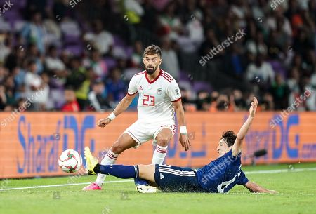 Stock Photo of Ramin Rezaeian of Iran passing the ball past Genki Haraguchi of Japan during Iran v Japan at the Hazza bin Zayed Stadium in Abu Dhabi, United Arab Emirates, AFC Asian Cup, Asian Football championship