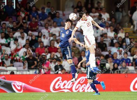 Sardar Azmoun of Iran and Wataru Endo of Japan challenging for the ball during Iran v Japan at the Hazza bin Zayed Stadium in Abu Dhabi, United Arab Emirates, AFC Asian Cup, Asian Football championship