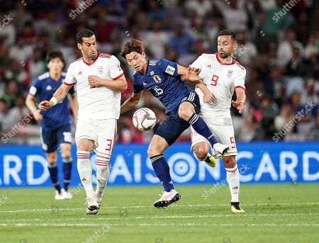 Yuya Osako of Japan taking the ball down in front of Omid Ebrahimi of Iran during Iran v Japan at the Hazza bin Zayed Stadium in Abu Dhabi, United Arab Emirates, AFC Asian Cup, Asian Football championship