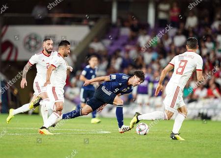 Omid Ebrahimi of Iran fouling Takumi Minamino of Japan during Iran v Japan at the Hazza bin Zayed Stadium in Abu Dhabi, United Arab Emirates, AFC Asian Cup, Asian Football championship