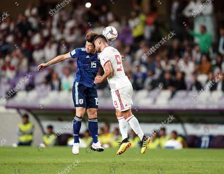 Takehiro Tomiyasu of Japan and Omid Ebrahimi of Iran challenging for the ball during Iran v Japan at the Hazza bin Zayed Stadium in Abu Dhabi, United Arab Emirates, AFC Asian Cup, Asian Football championship