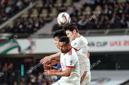 Sardar Azmoun of Iran and Omid Ebrahimi of Iran trying to head the ball during Iran v Japan at the Hazza bin Zayed Stadium in Abu Dhabi, United Arab Emirates, AFC Asian Cup, Asian Football championship