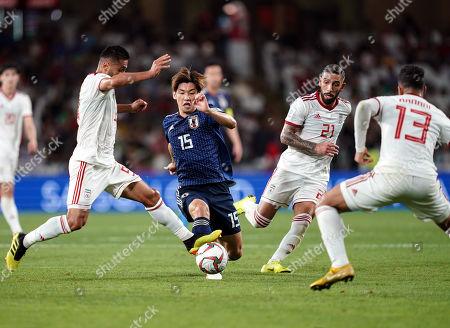 Stock Image of Omid Ebrahimi of Iran fouling Yuya Osako of Japan during Iran v Japan at the Hazza bin Zayed Stadium in Abu Dhabi, United Arab Emirates, AFC Asian Cup, Asian Football championship